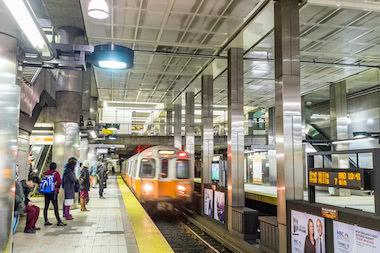 People waiting as orange line train arrives inside North Station