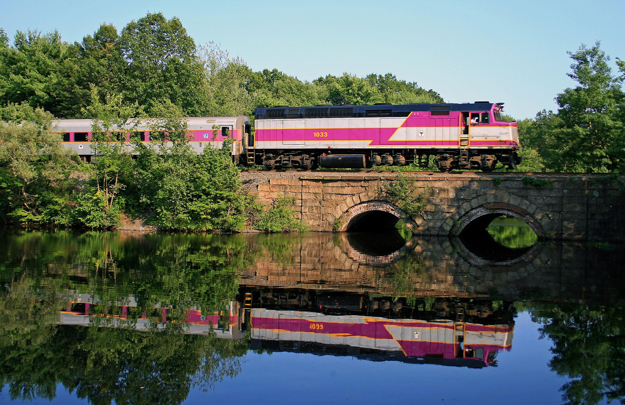 Commuter Rail train crossing a bridge in Ashland