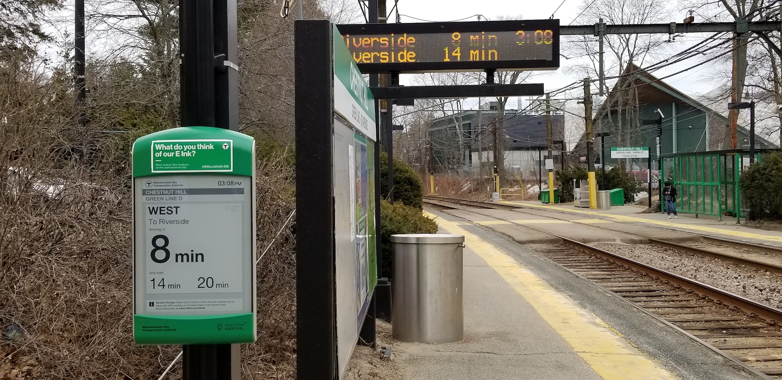 An e-Ink sign on the westbound platform at Chestnut Hill