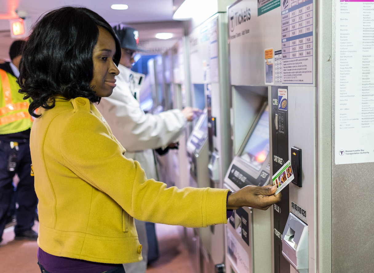 Woman using fare vending machine