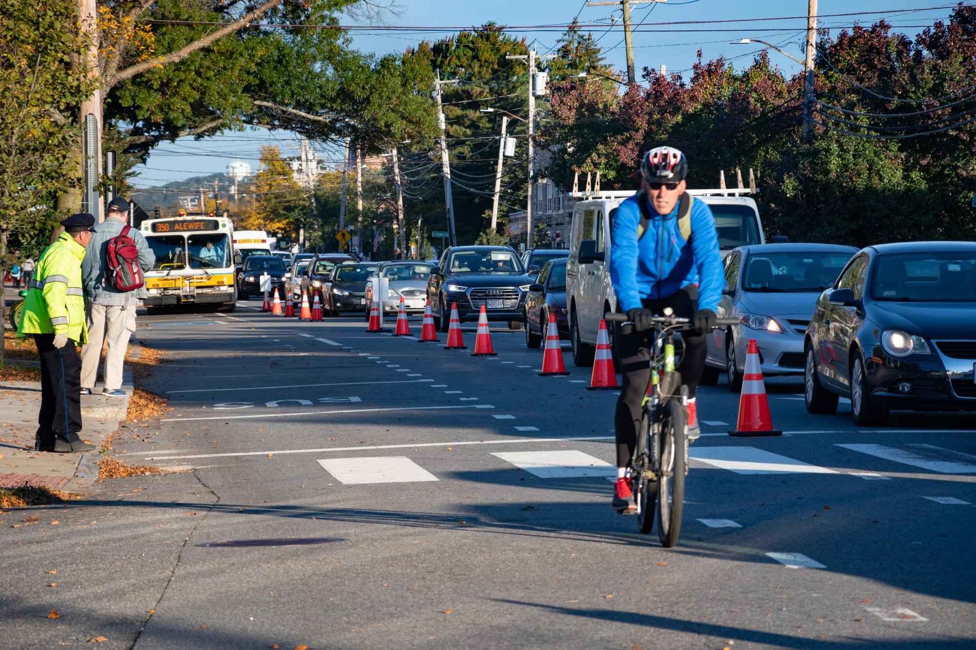 A cyclist rides in the shared bus/bike lane during the Arlington pilot.