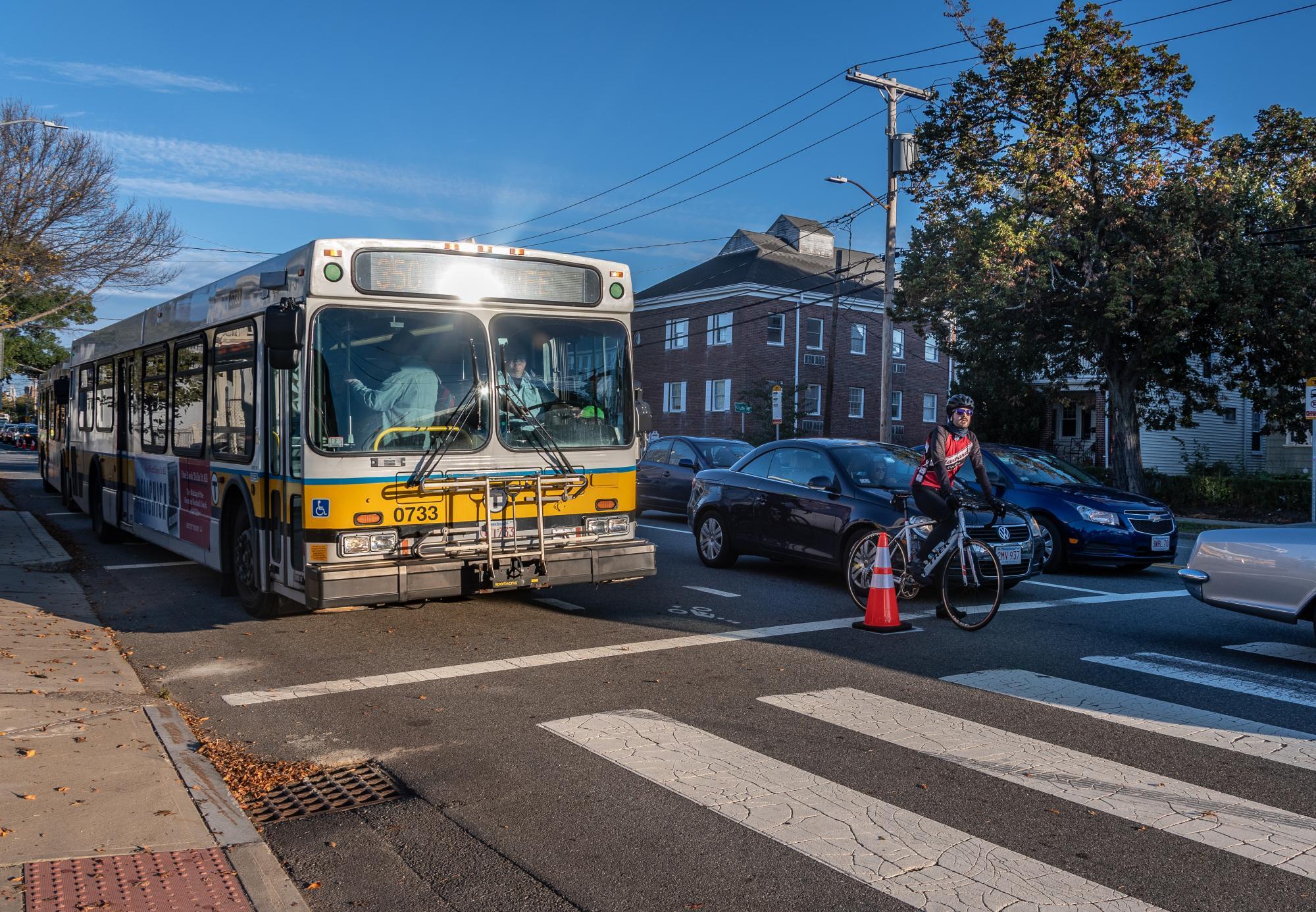 A bus next to car traffic during the Arlington pilot.