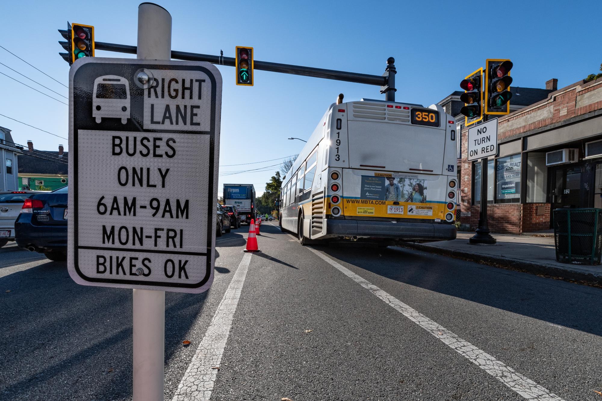 """Right Lane | Buses Only | 6 AM - 9 AM | Mon-Fri | Bikes OK"" sign during the Arlington pilot."
