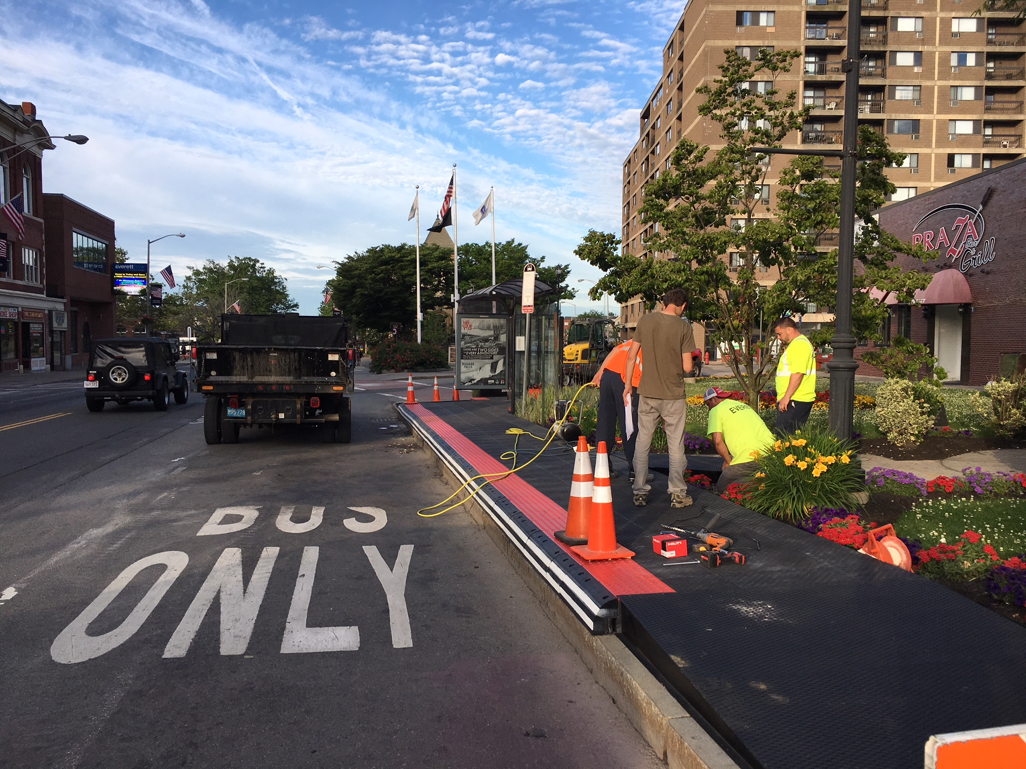 "A crew paints ""Bus Only"" in the new permanent lane."