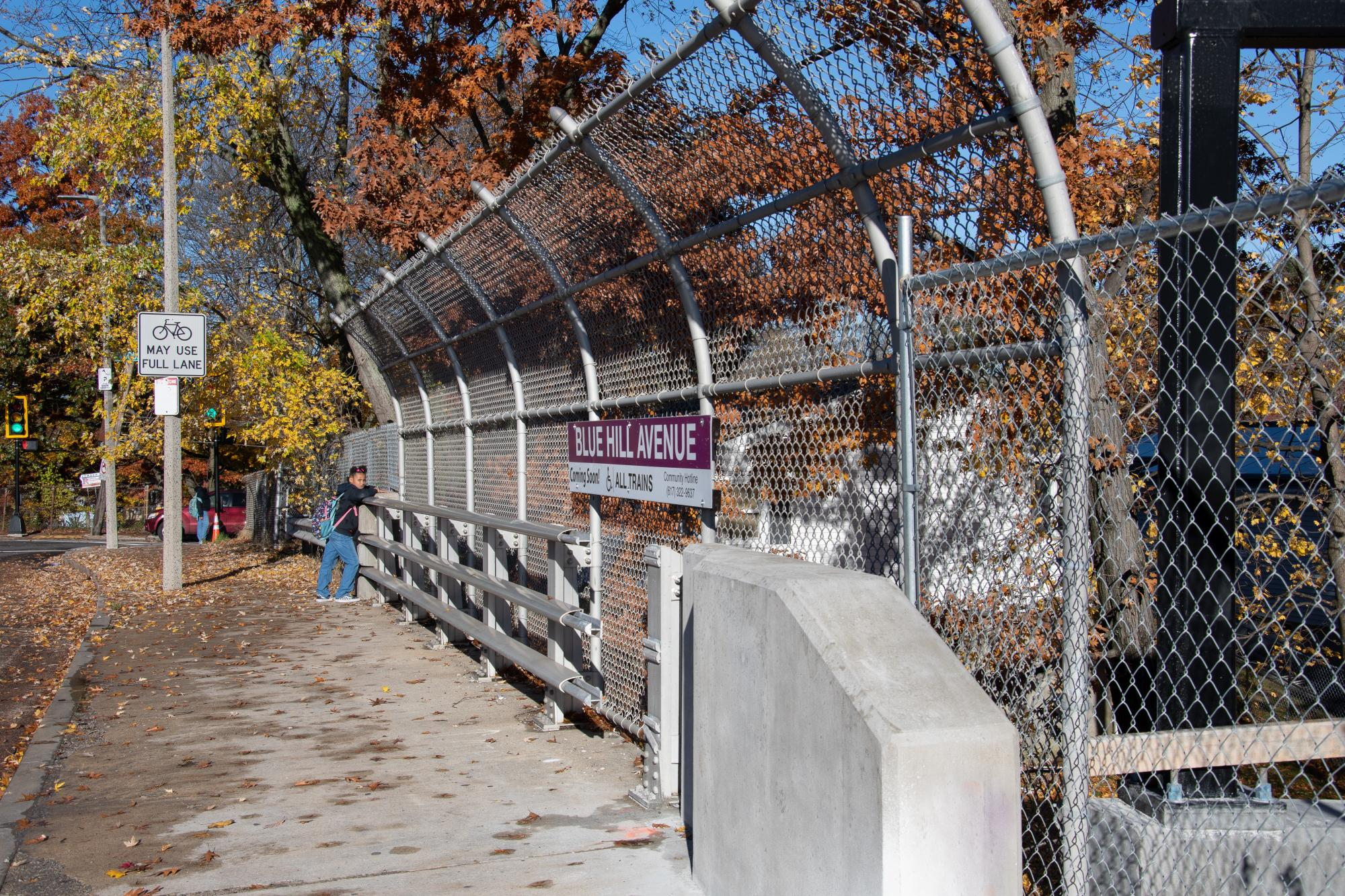 Blue Hill Ave station sign on adjacent bridge (November 2018)