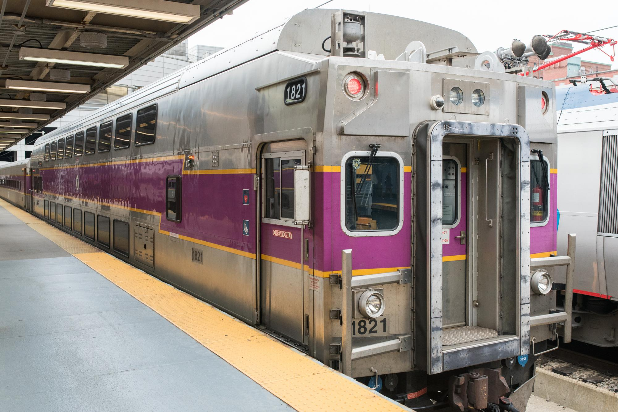Commuter rail train at a station platform.