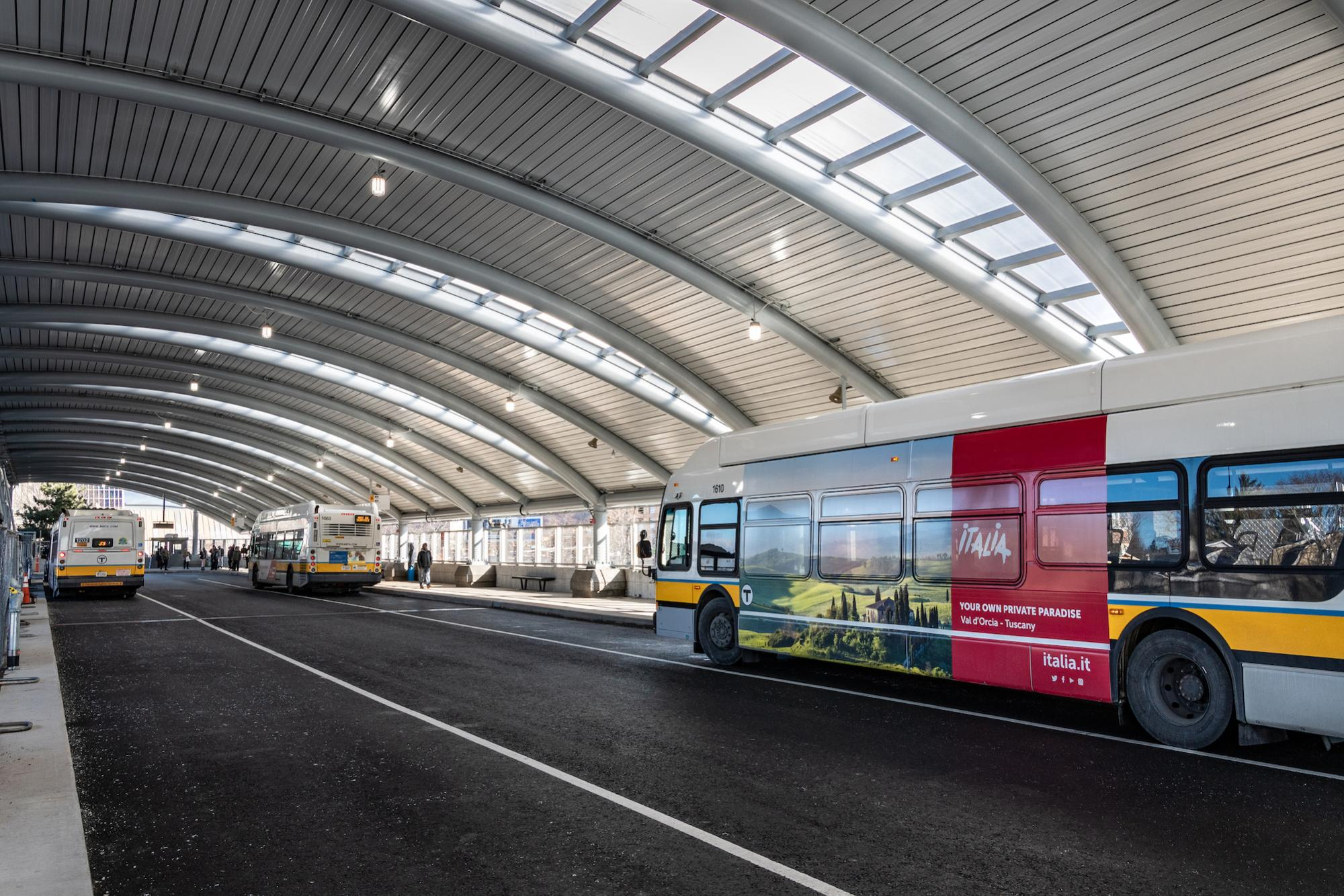 Buses driving through the new upper busway canopy at Forest Hills (January 4, 2019)
