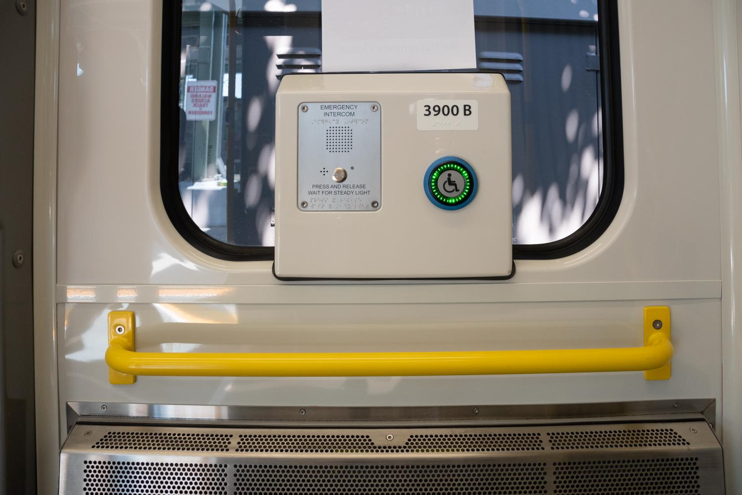 Intercom and yellow grab railing on new Green Line car (July 2018)