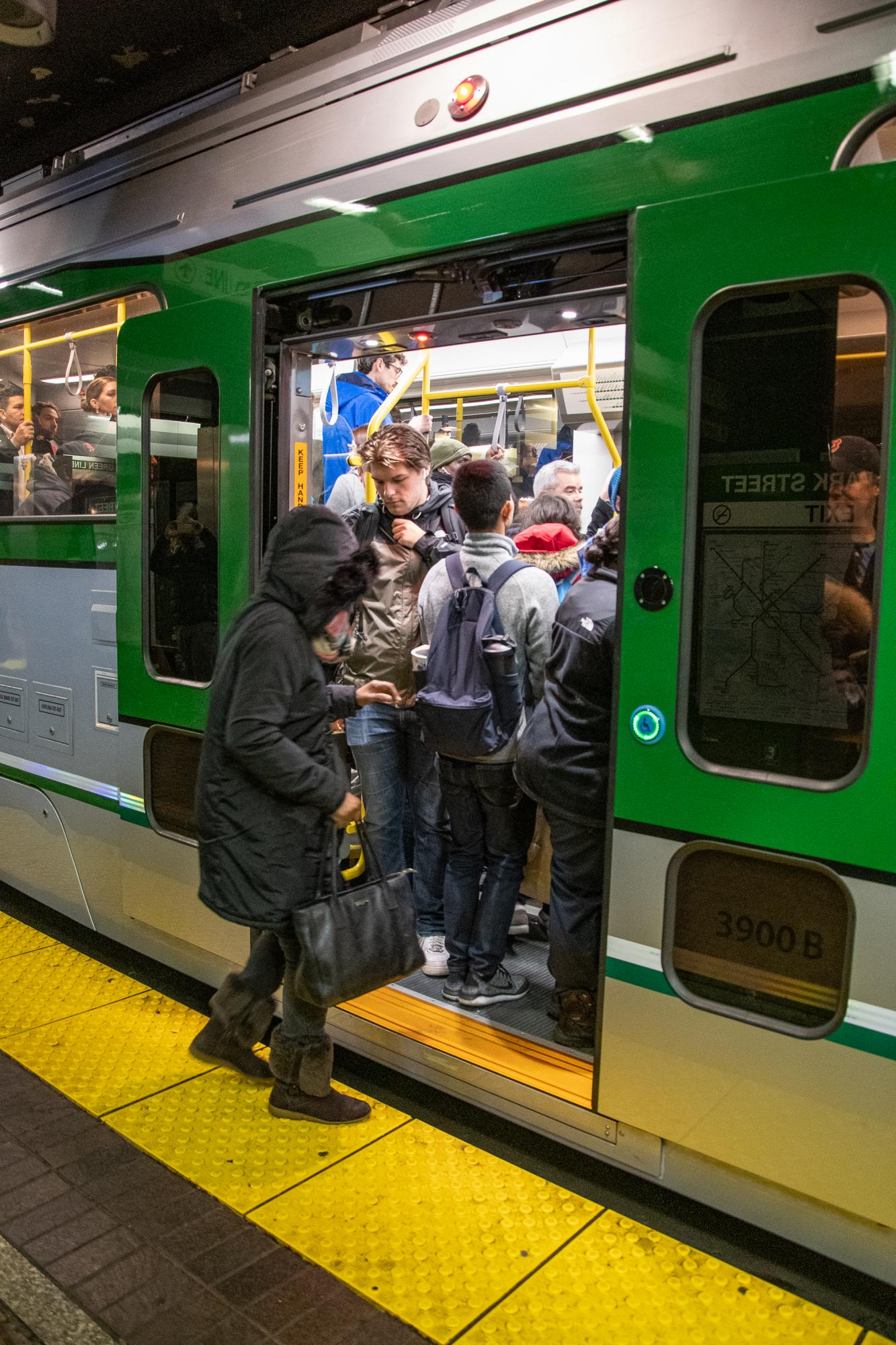 Passengers at North Station board the first new Green Line vehicle in service (December 21, 2018).