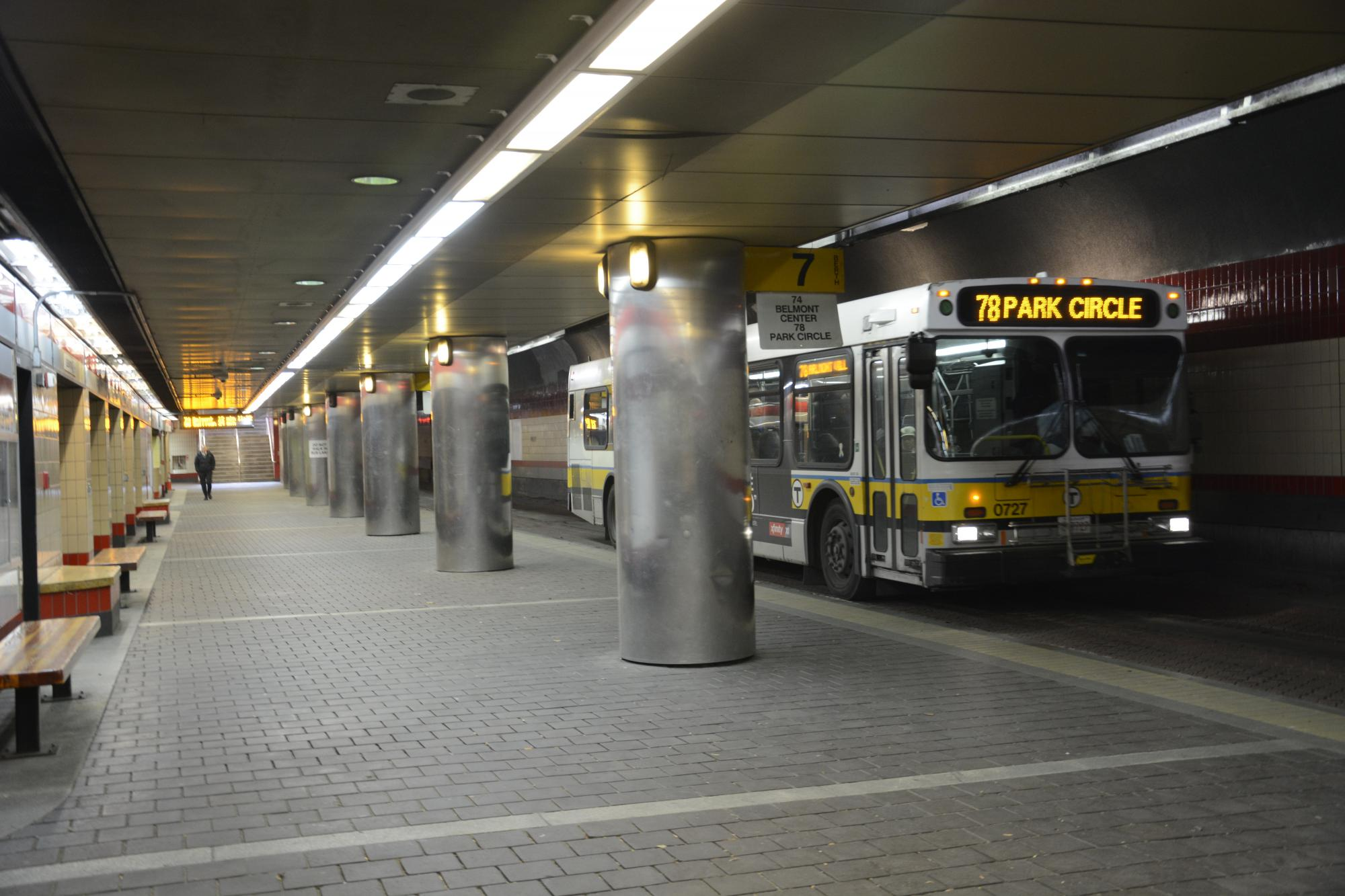 A Route 78 bus pulls into the upper busway at Harvard Station.