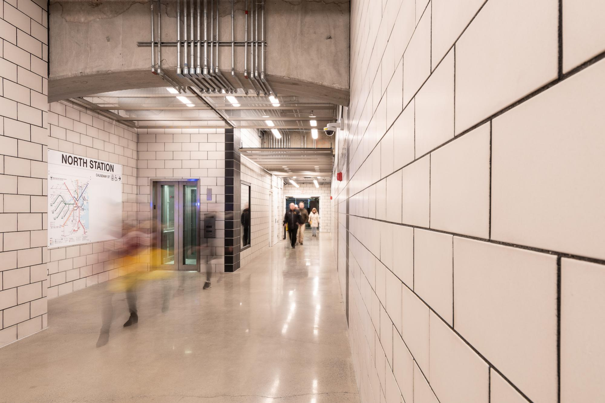 Riders traverse the new North Station underground walkway (January 7, 2019)