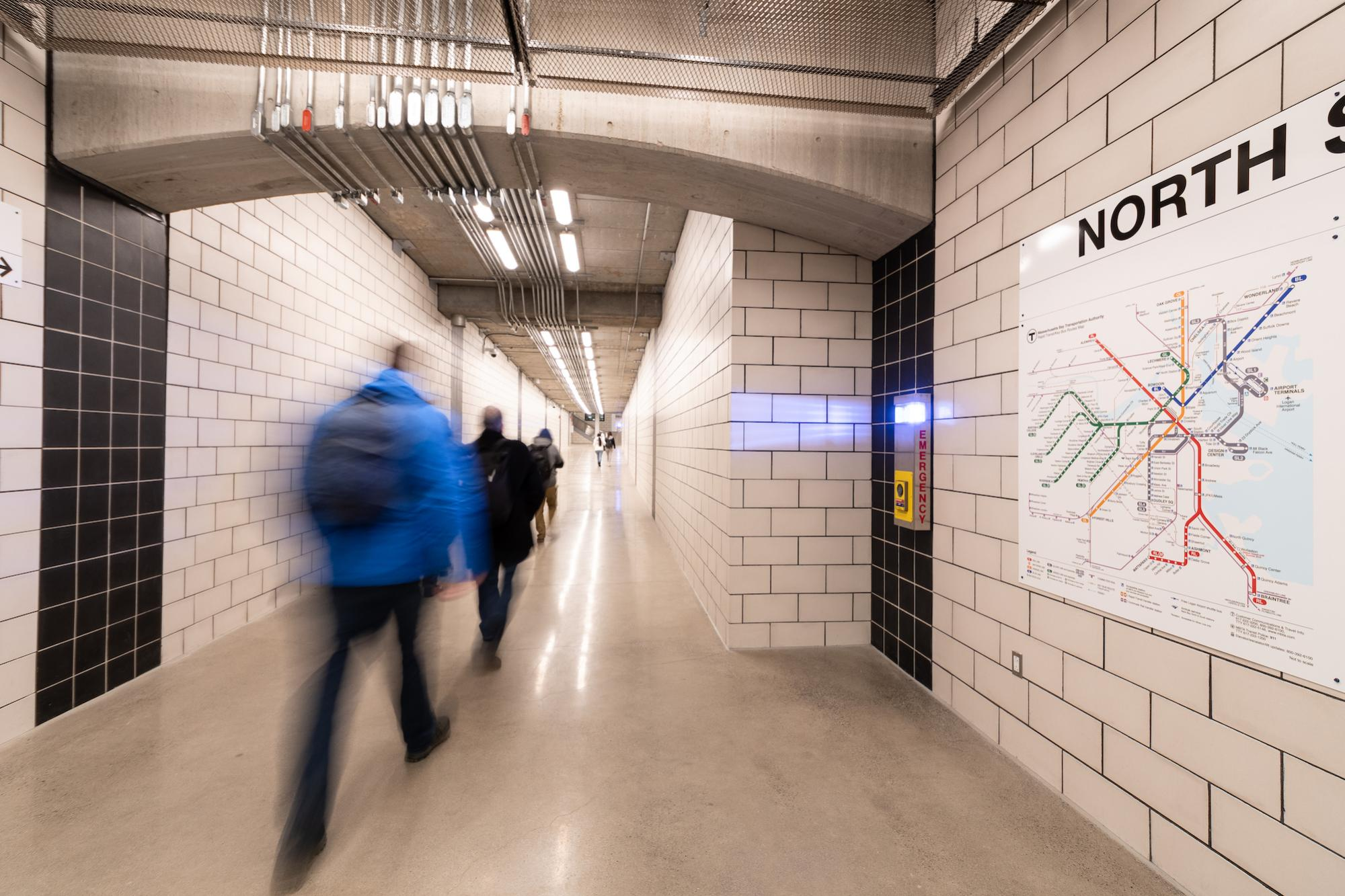 Riders traverse the new North Station underground walkway