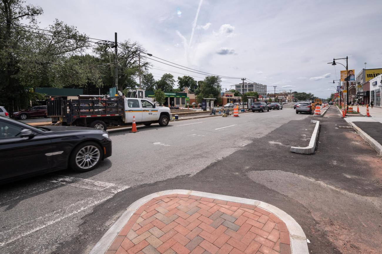 Construction at the Pleasant St stop during summer 2018, showing a newly paved bicycle lane.