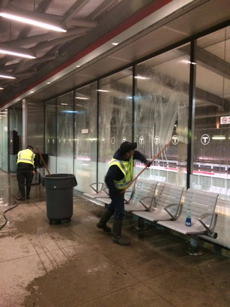 A worker cleans station windows at Ashmont