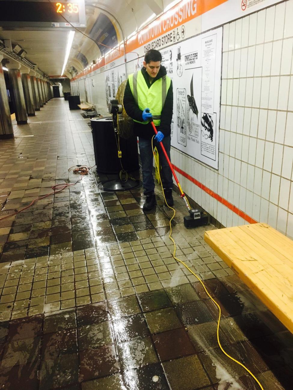 A worker cleans at Downtown Crossing