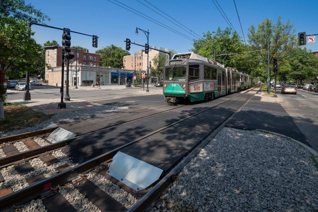 A Green Line train passes over a newly completed intersection upgrade on the C Line at Carlton St (July 2019)