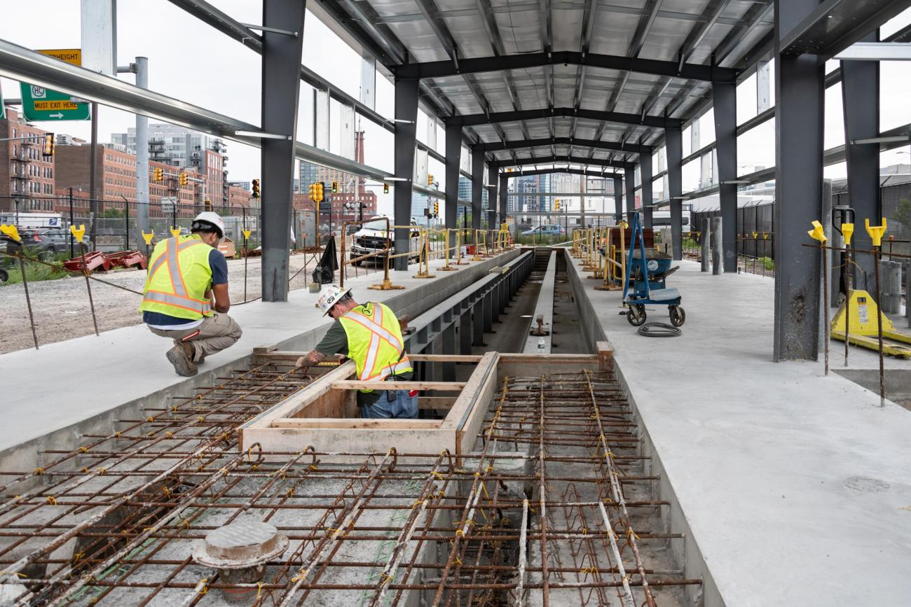 A crew works on constructing a new storage facility