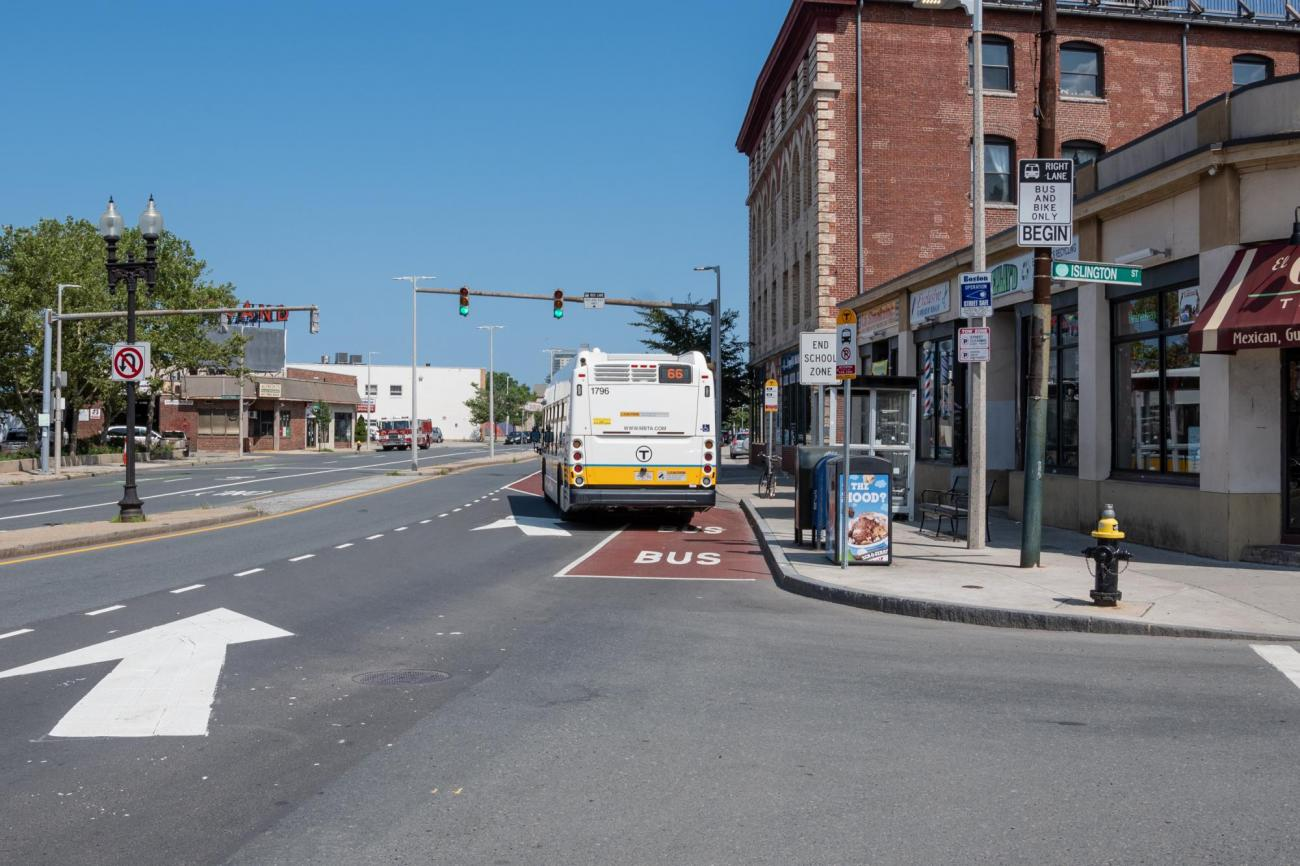 The 66 bus travels inbound in a dedicated bus and bike lane on Brighton Ave in Allston, near Union Square. (July 2019)
