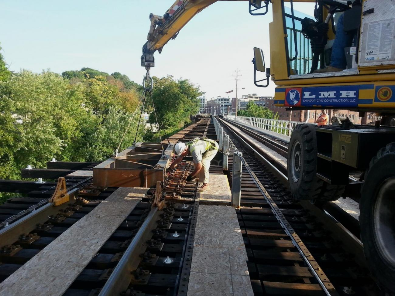 A crewman works on the rails on the Merrimack River Bridge