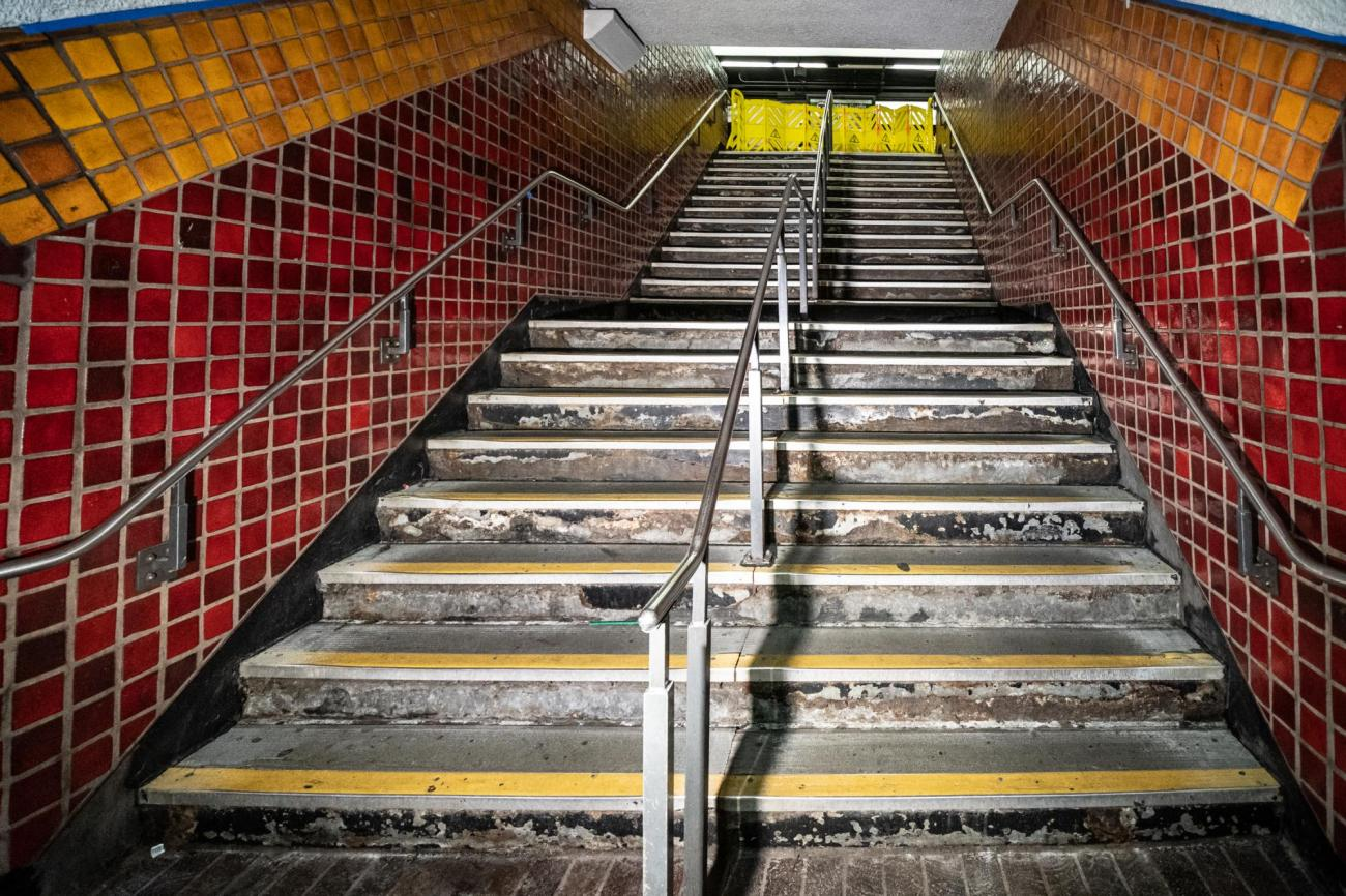 Stairs connecting the Red and Green Line platforms at Park Street, before cleaning and repair