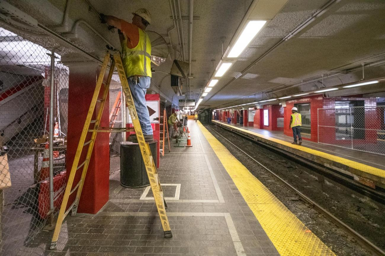 MBTA crews clean and repair the walls and ceiling of the Red Line platform at Park Street Station.