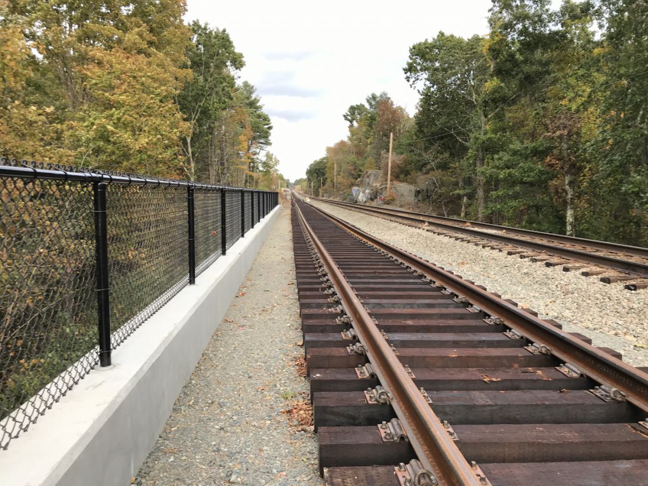 Completed retaining wall with new second track assembled outside of Walpole Station in 2019
