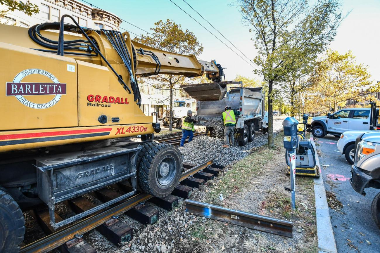 Workers replace track on Beacon Street between Carlton Street and Hawes Street during weekend work October 19 and 20, 2019.