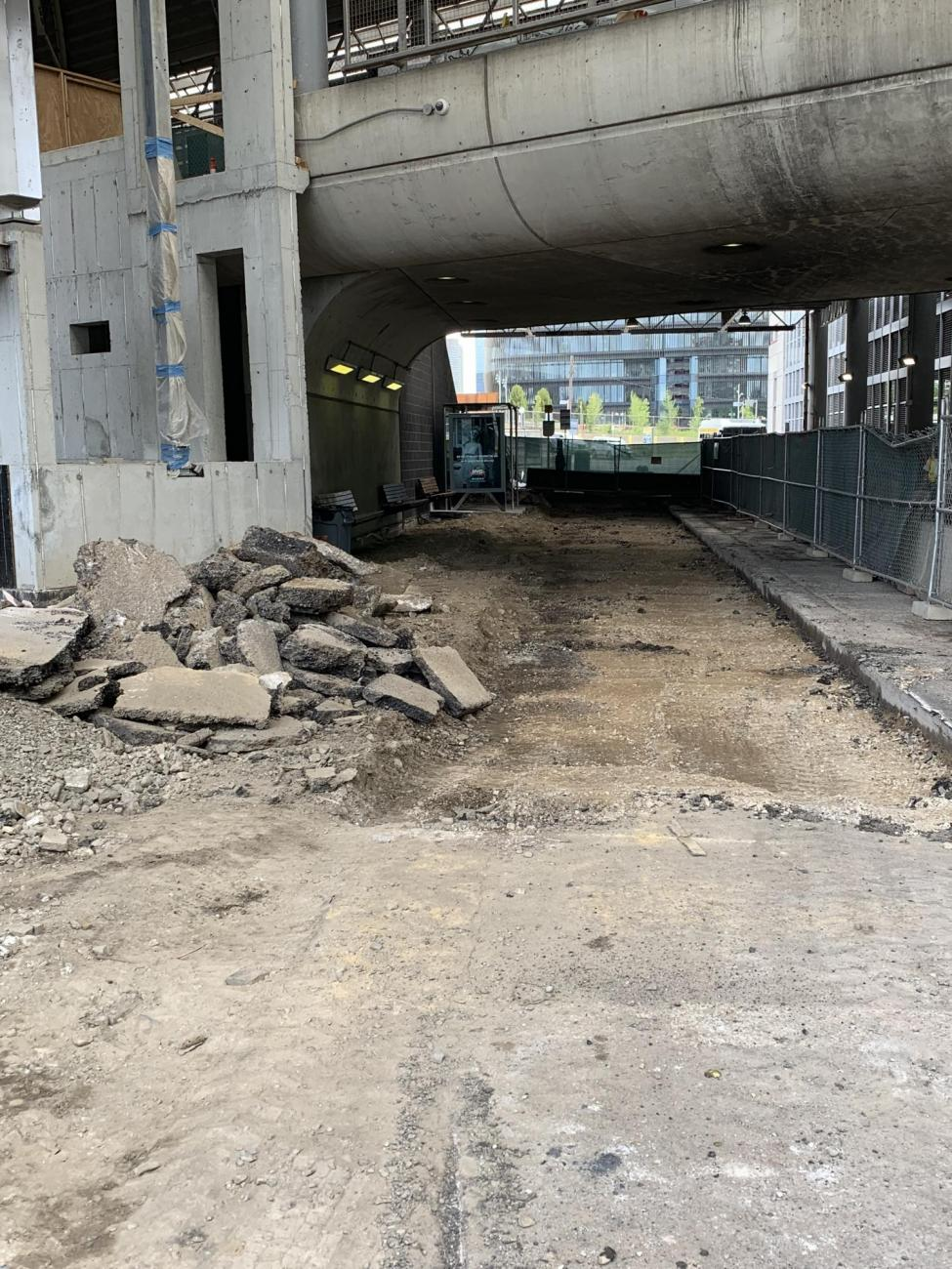Excavated pavement in the lower busway in preparation for regrading and stormwater drainage installation