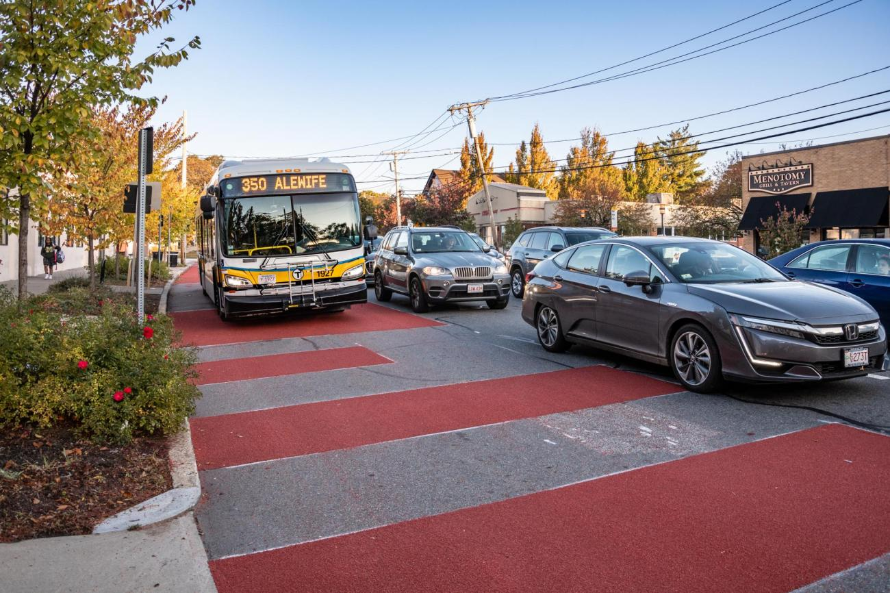 A closeup of a bus approaching in the new bus lane on Mass Ave in Arlington