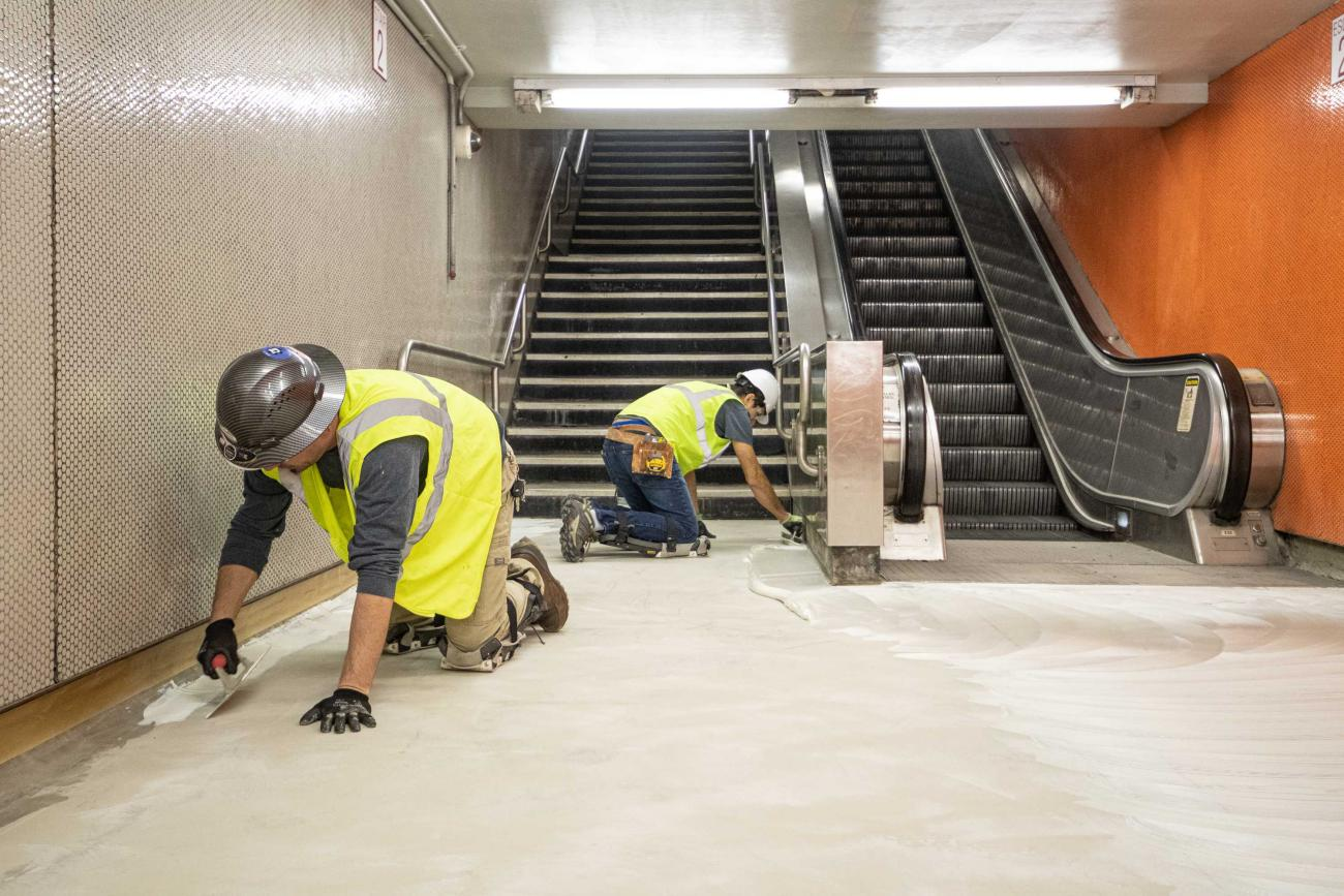 Crew members prepare the floors for replacement in Downtown Crossing's Alewife Passage during the December 13 – 15, 2019, Red Line weekend shutdown