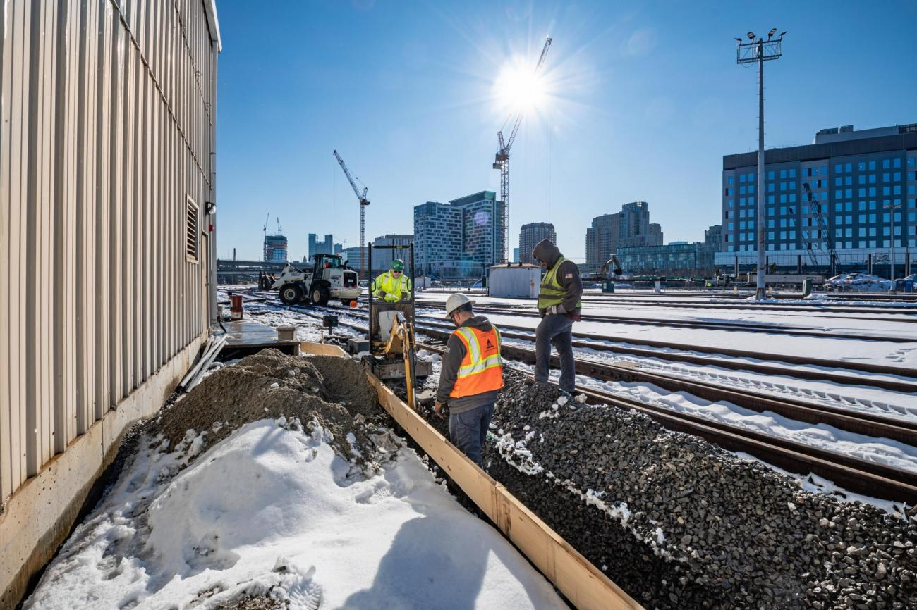A crew works on PTC upgrades at the Commuter Rail engine terminal in Boston (December 2019)
