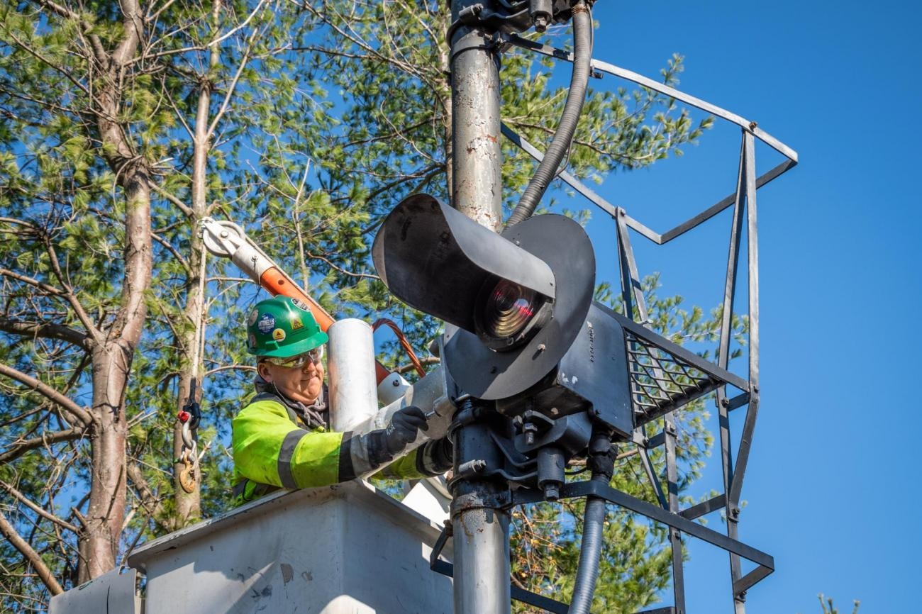 A crew member installs PTC signal upgrades on the Fitchburg Line of the Commuter Rail (November 2019)