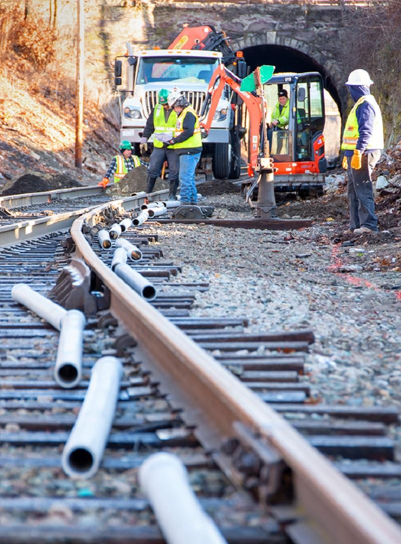 A crew prepares to install track signal communication line near Walpole Station on the Franklin Line of the Commuter Rail (January 2020)