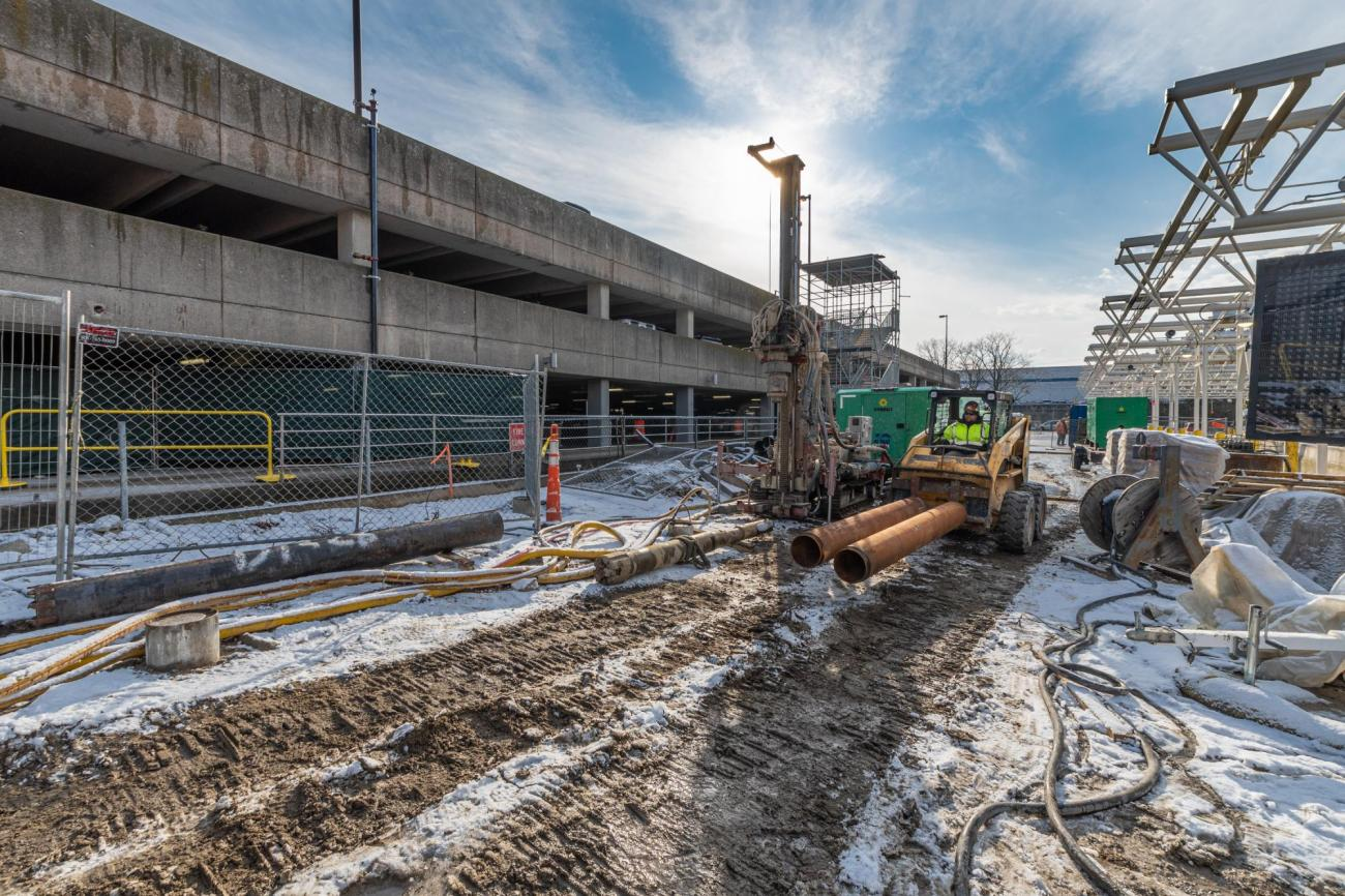 Crew members work on the new busway outside of Braintree Station Garage (January 8, 2020)