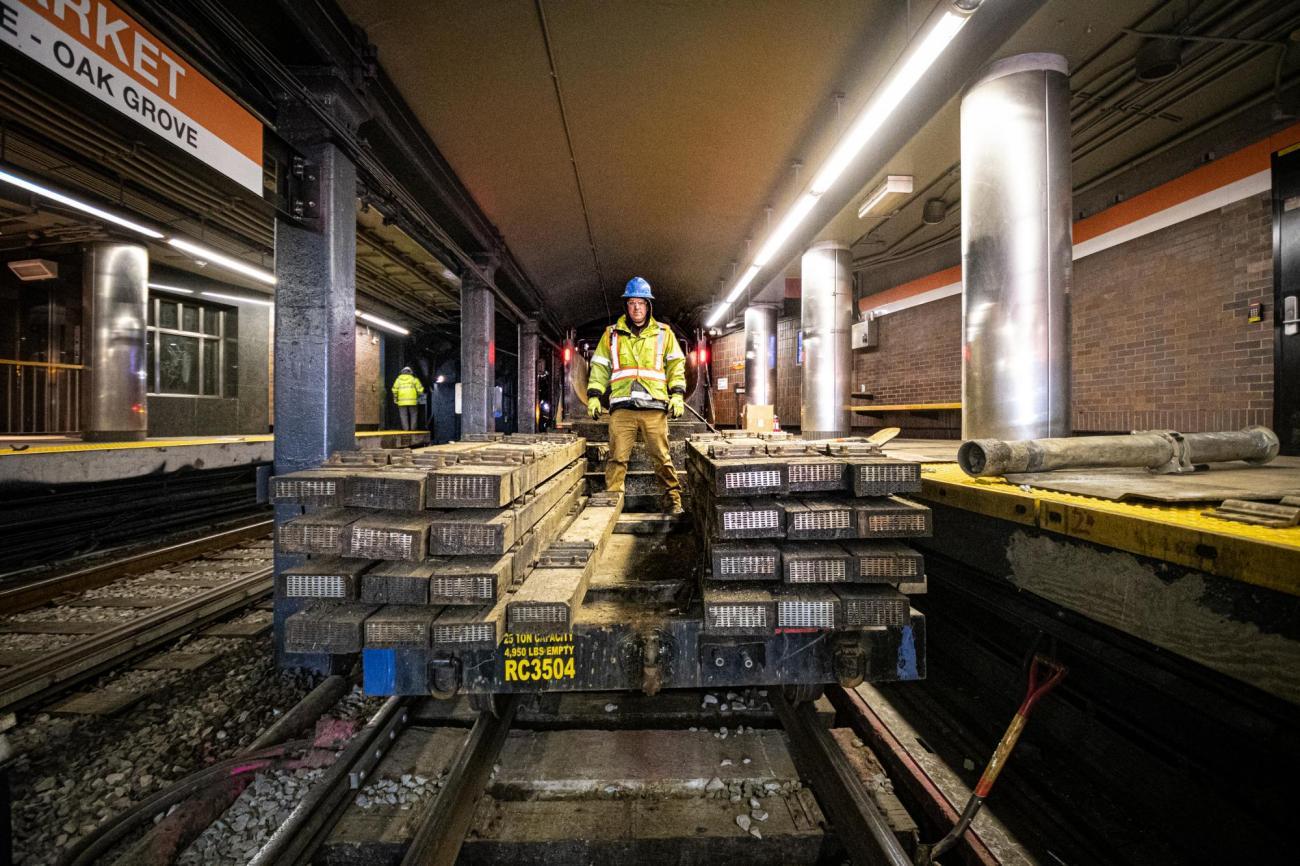 A crew member brings rail ties into Haymarket during the final Orange Line weekend shutdown of winter 2020