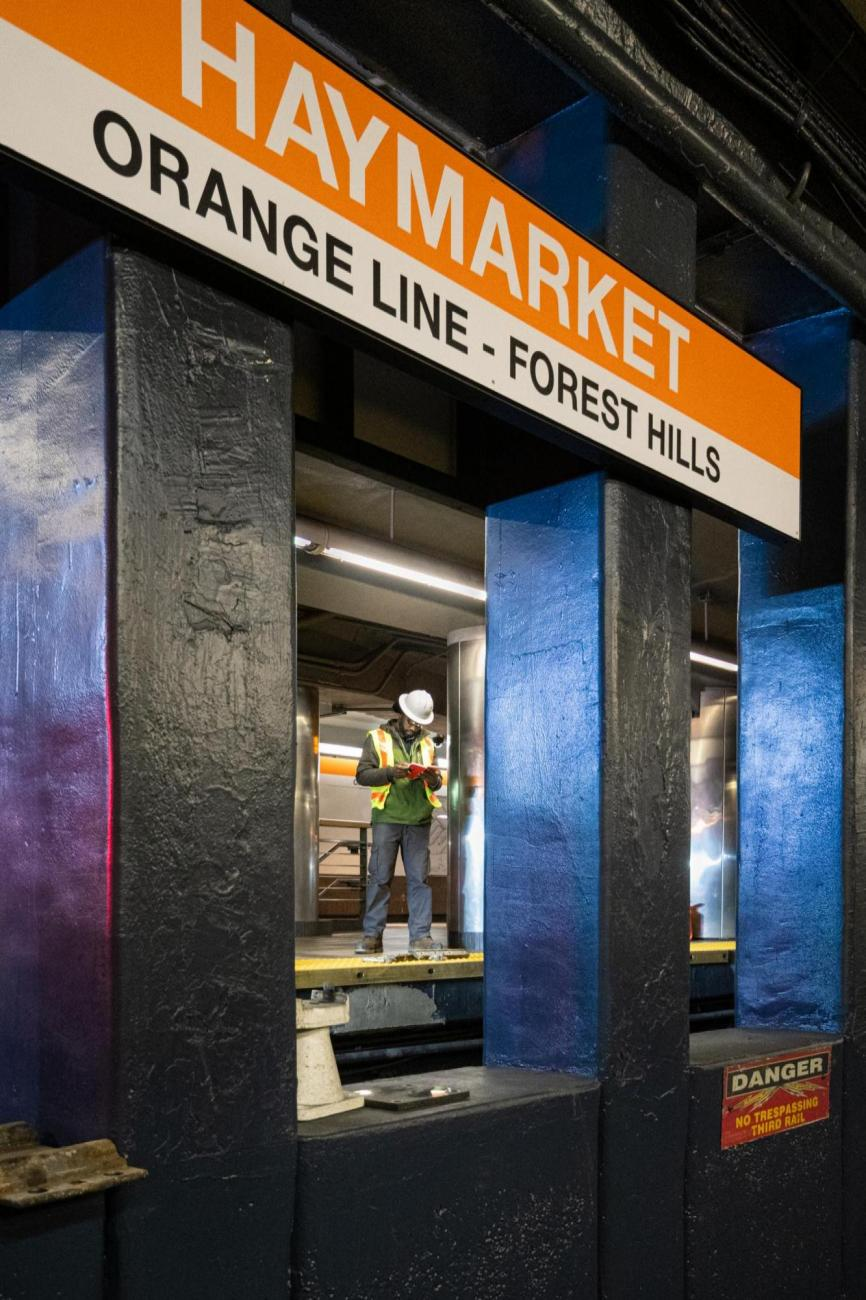 A crew member prepares for rail tie replacement at Haymarket during the final Orange Line weekend shutdown of winter 2020