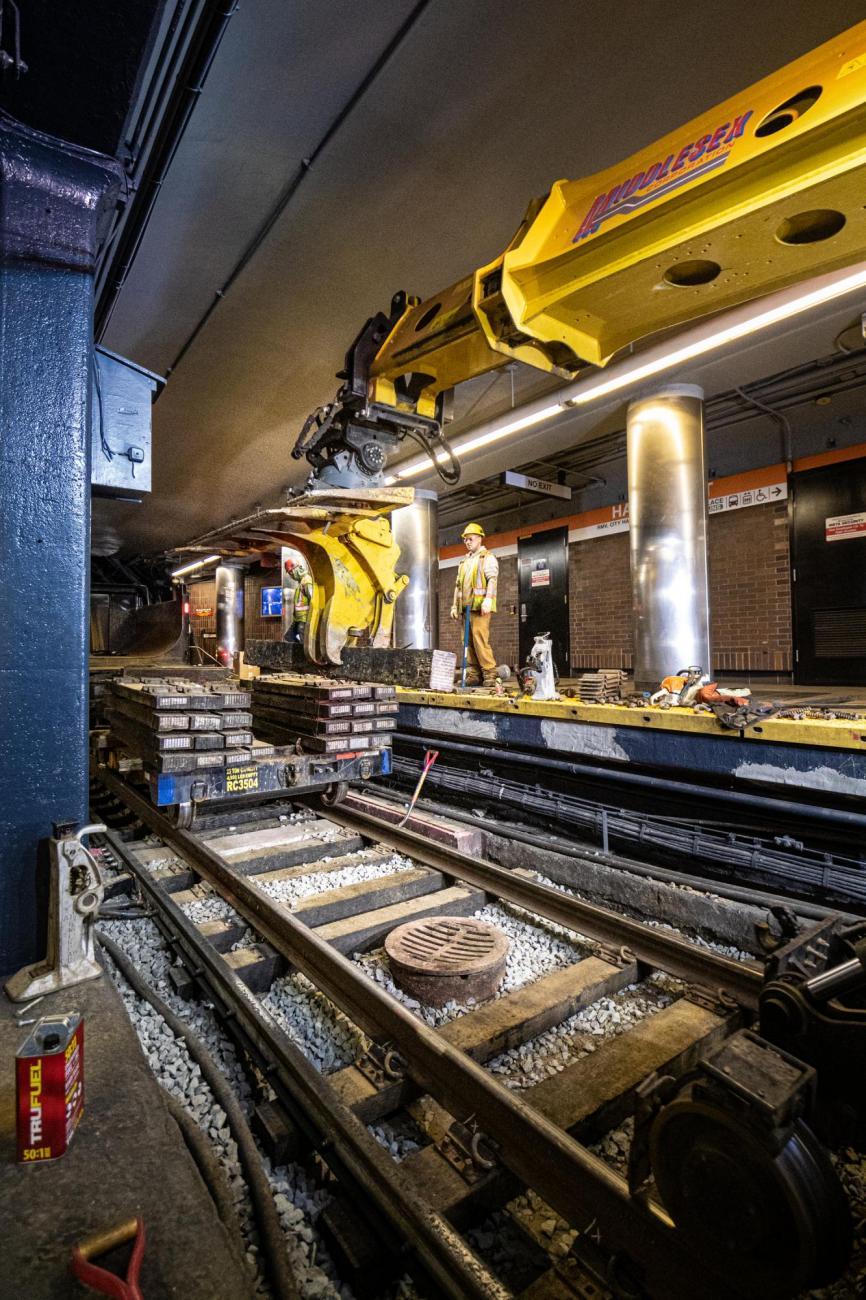 Crew members bring rail ties into Haymarket as part of the final Orange Line weekend shutdown of winter 2020