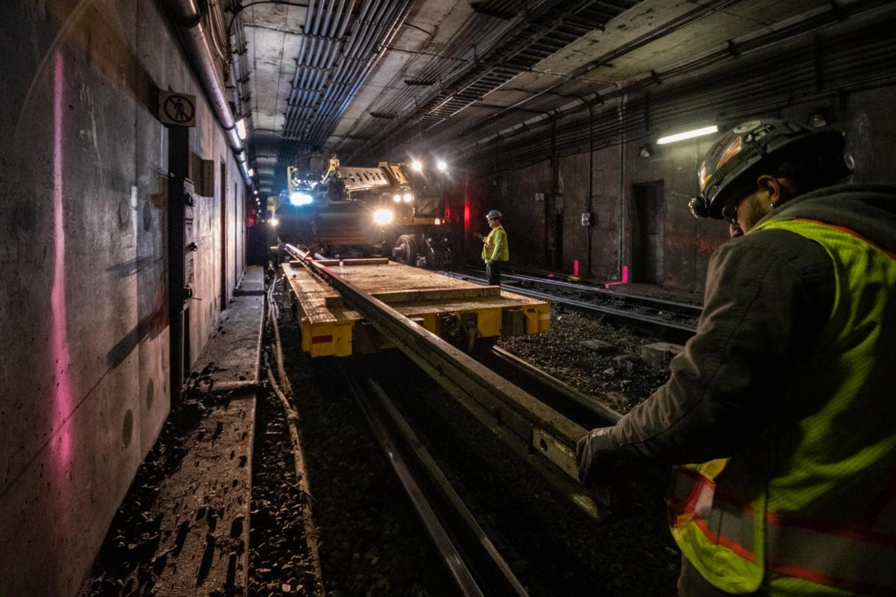 Crew members prepare to install replacement rail on North Station's southbound side during the February 7 – 9, 2020, Orange Line weekend shutdown