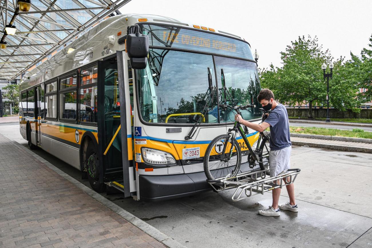 Bikes   A man places his bike into a bus bike rack   Haymarket   (July 2020)