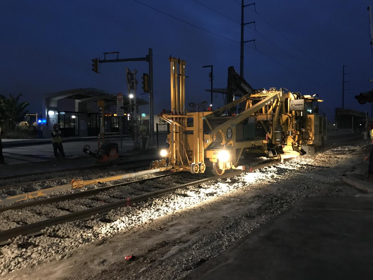 Machinery is used to tamp the new tracks and align them with the existing rail