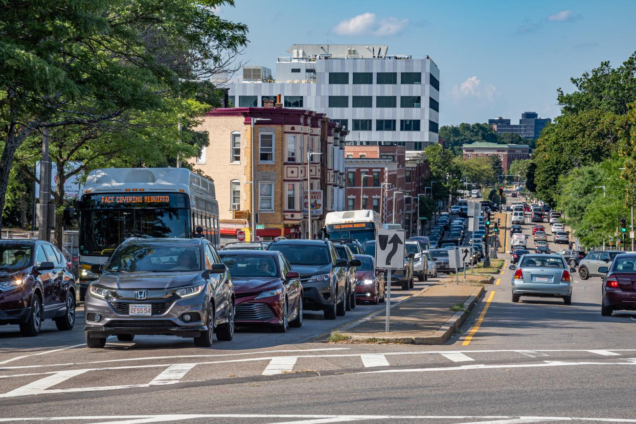 Buses caught in traffic on Columbus Avenue during rush hour.