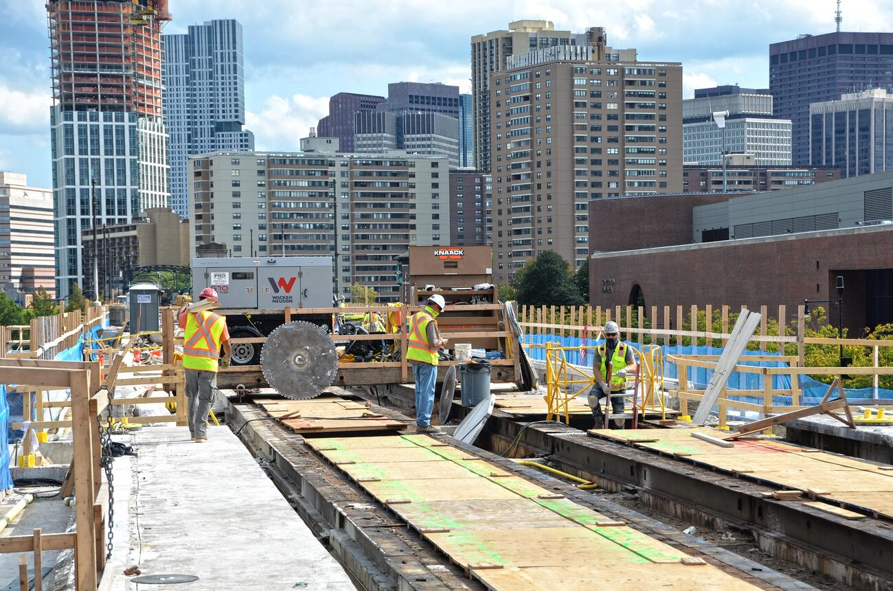 A crew reconstructs Green Line E track as part of the Lechmere Viaduct Rehabilitation