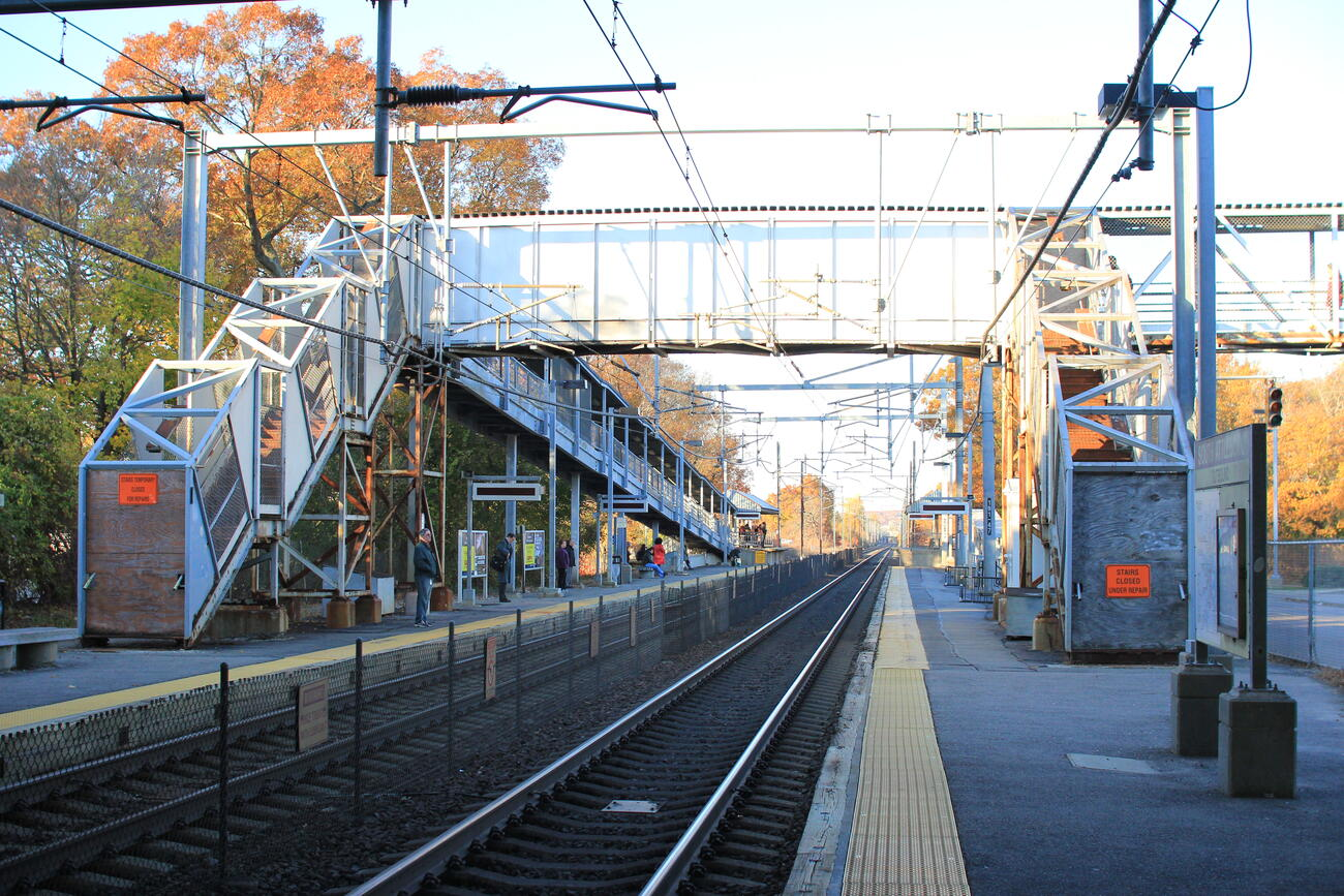 View of the pedestrian bridge closed for repairs on the South Attleboro Commuter Rail platform