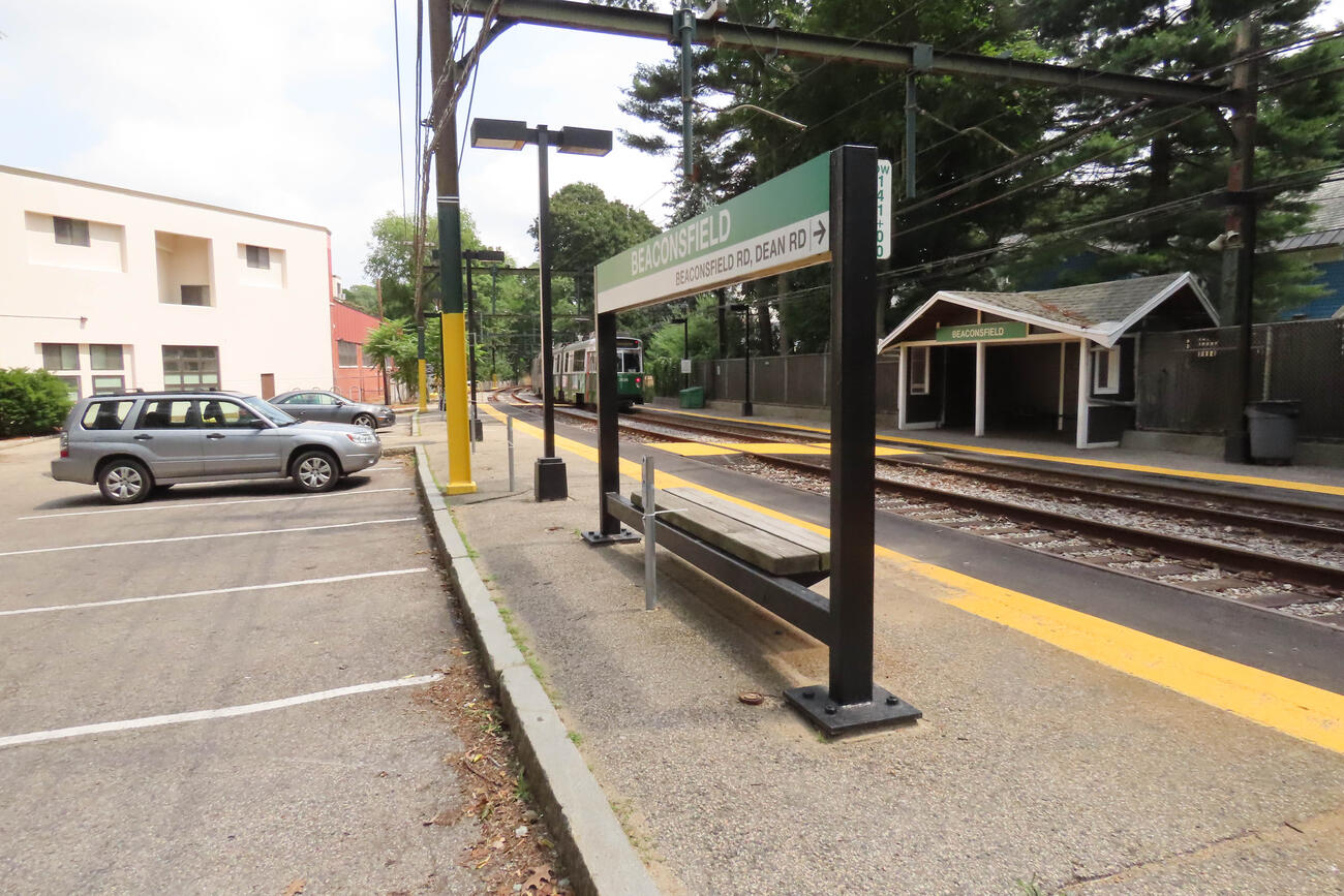 The Beaconsfield station platform. A green line train is visible in the distance