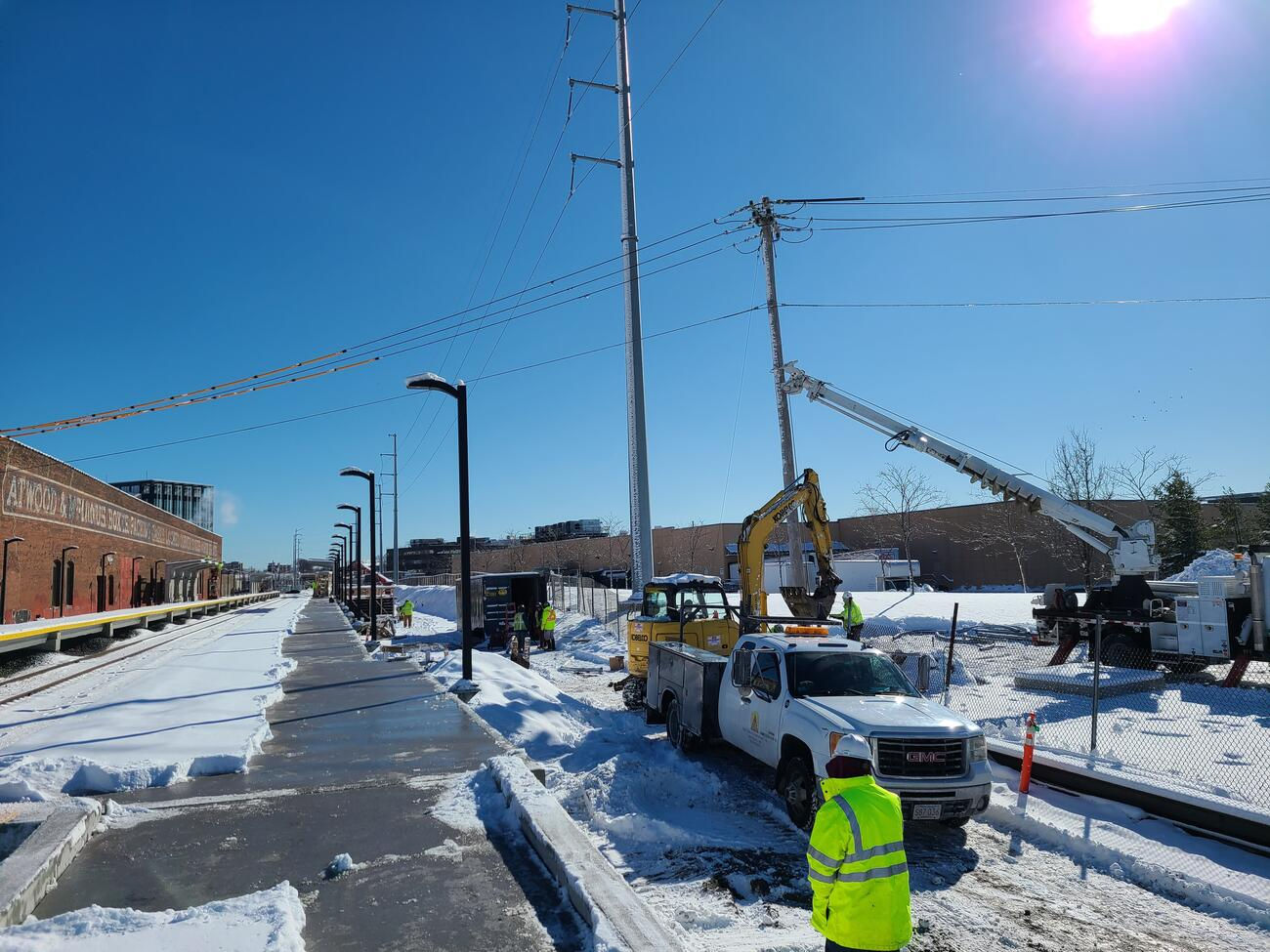 Crews installing part of new electrical service in the area of the outbound platform for the new Chelsea Commuter Rail Station