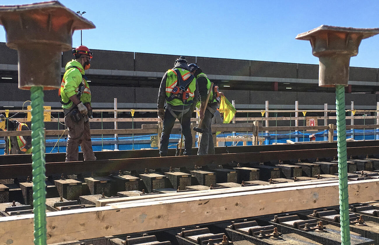workers securing rail