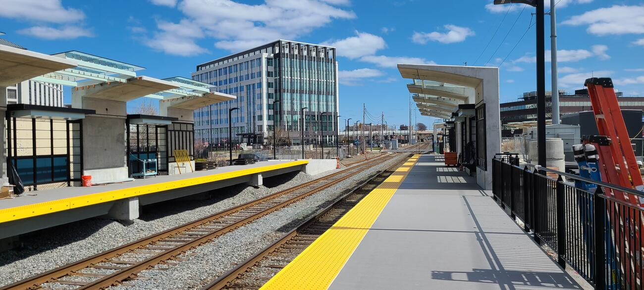 The new Chelsea Commuter Rail Station with inbound and outbound platforms, canopies, and glass panels installed