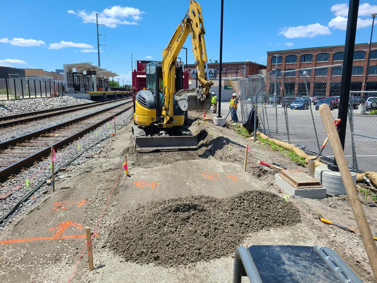 Crews lay crushed stone to build the northeast walkway to the new Chelsea Commuter Rail Station.