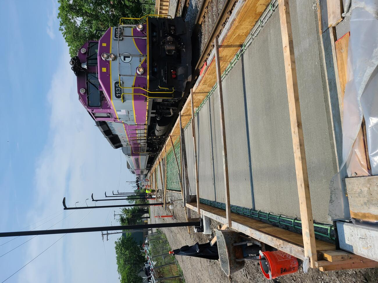New concrete along the southwest walkway to the new Chelsea Commuter Rail Station