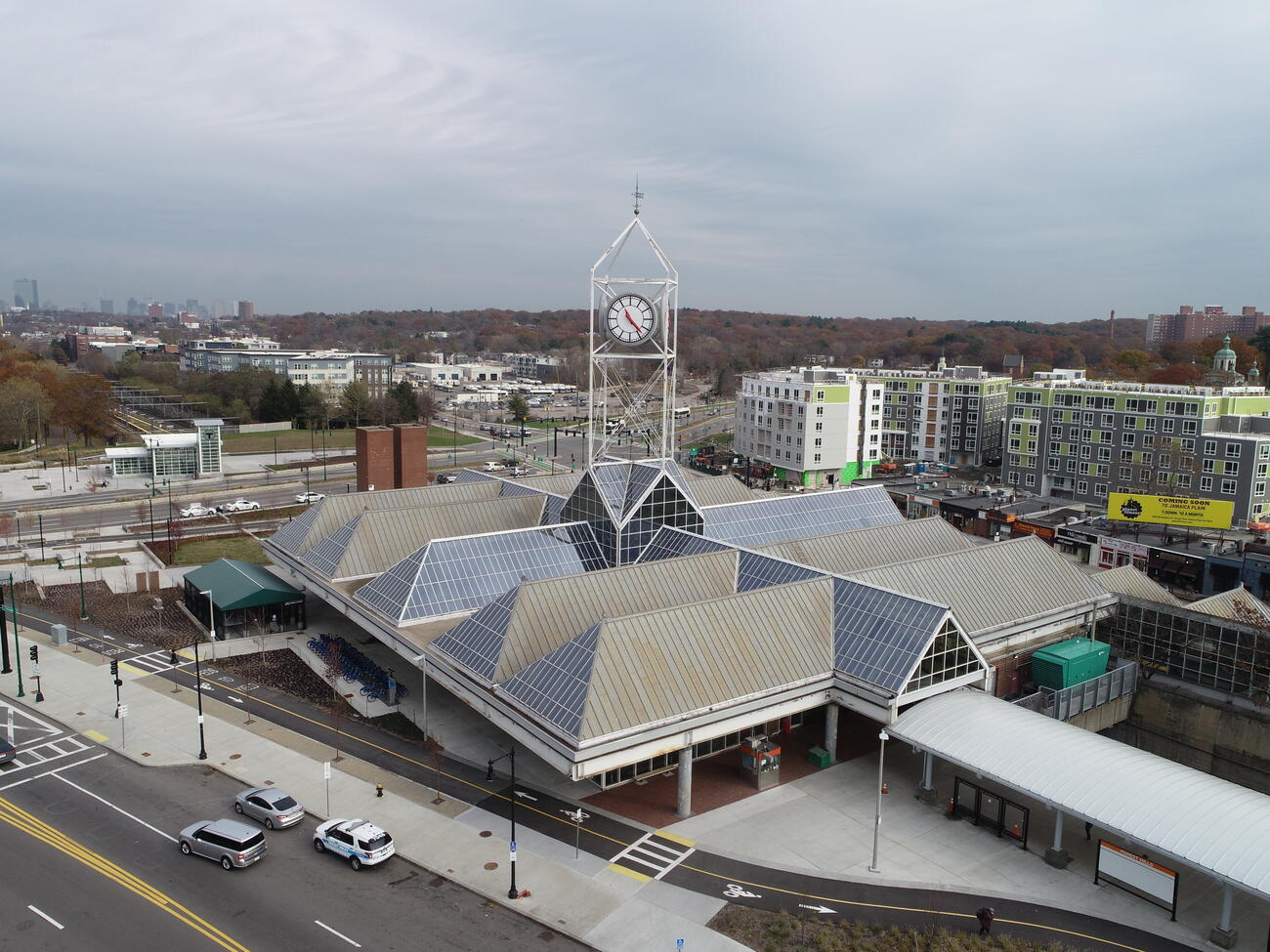 An aerial shot of Forest Hills Station showing the geometric glass and metal roof